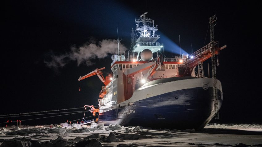 The research icebreaker Polarstern in the ice at night during the Arctic expedition MOSAiC.